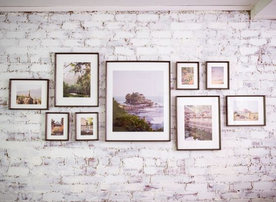 Custom framed photos and artwork make up this gallery wall