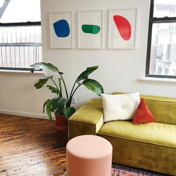 Trio of artwork custom framed in a living room