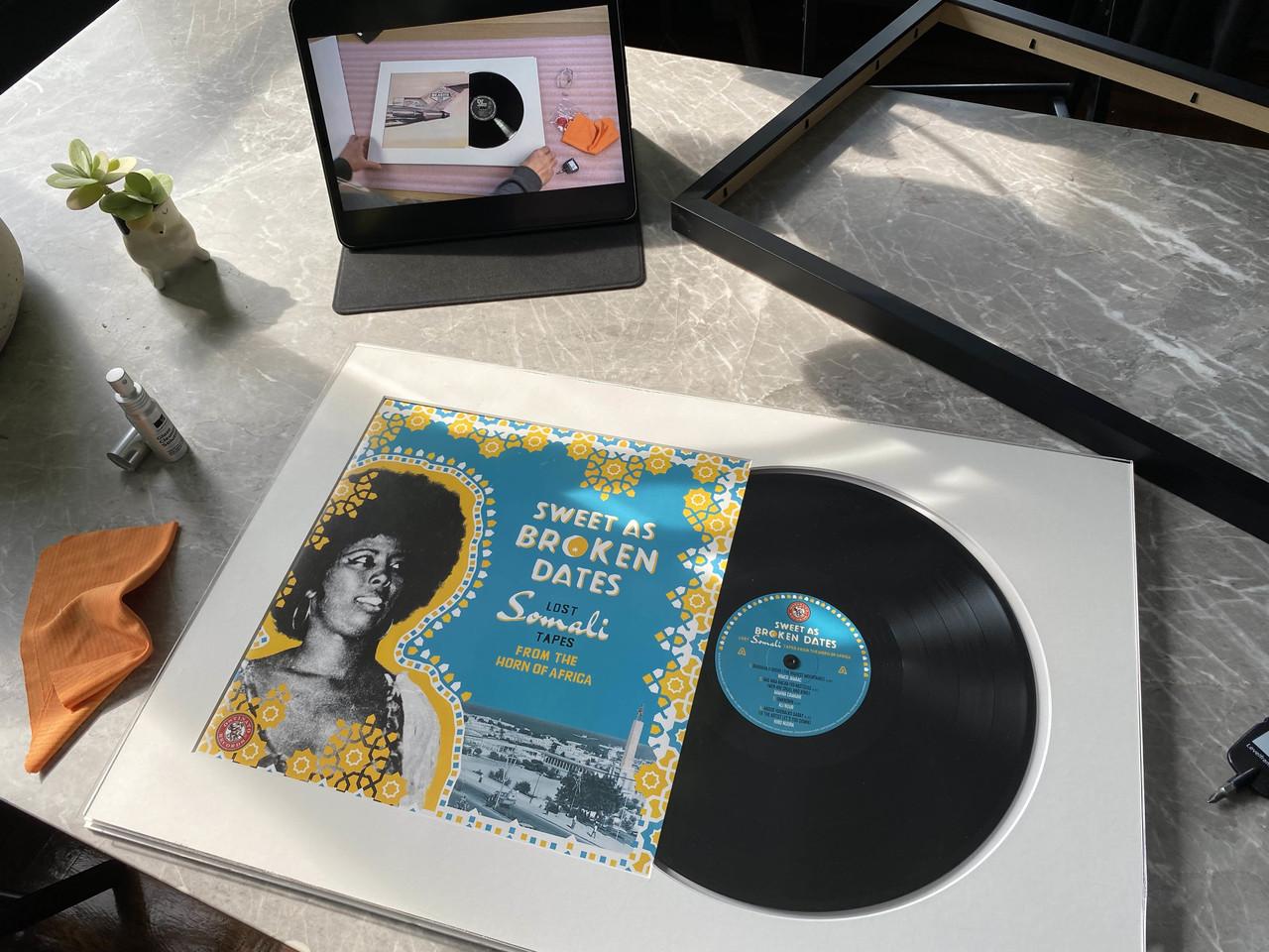 Custom framed vinyl Ostinato Records